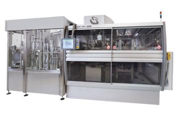Sistema integrado de Sopro, Envase e tamponamento para líquido não gasoso.